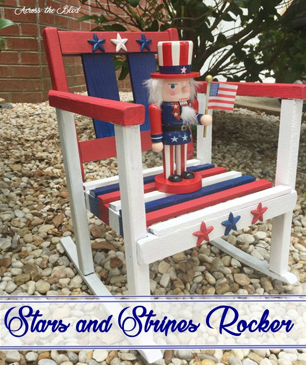 Small rocking chair painted red white and blue with uncle sam nutcracker on it