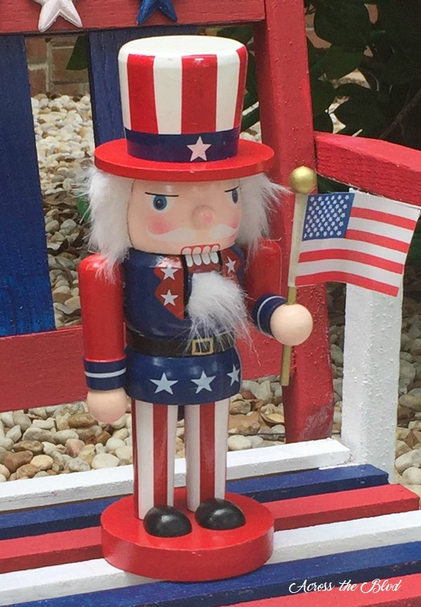 uncle sam nutcracker sitting on a small red white and blue rocking chair