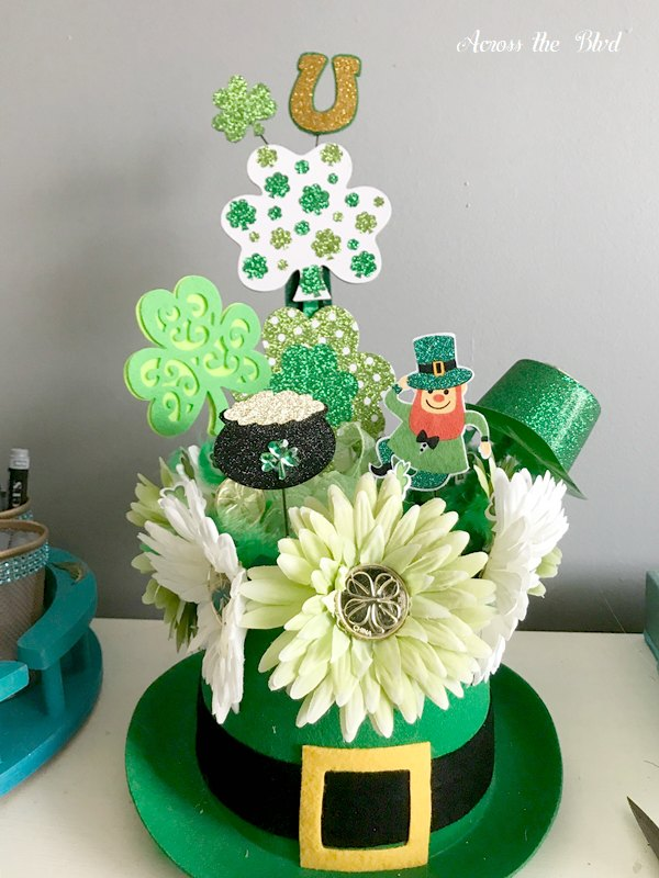 leprechaun hat with flowers, picks, shamrocks and floral picks