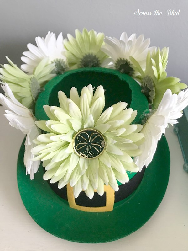 faux daisies on leprechaun hat