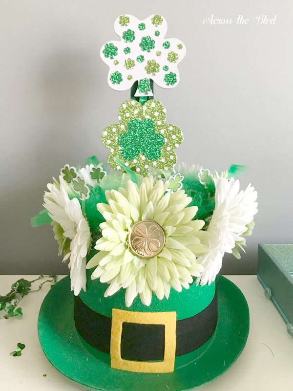 faux flowers and shamrocks on leprechaun hat