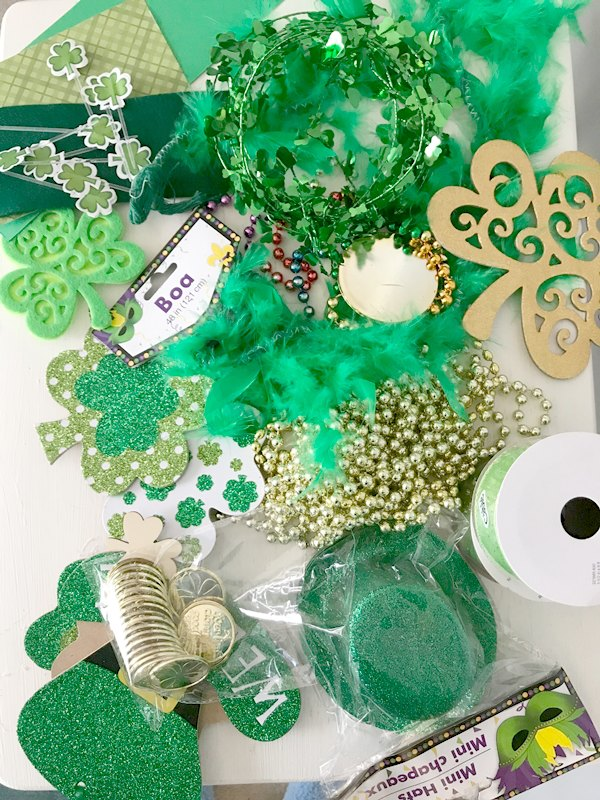 green boa, shamrocks, floral picks for St Patrick's Day Centerpiece