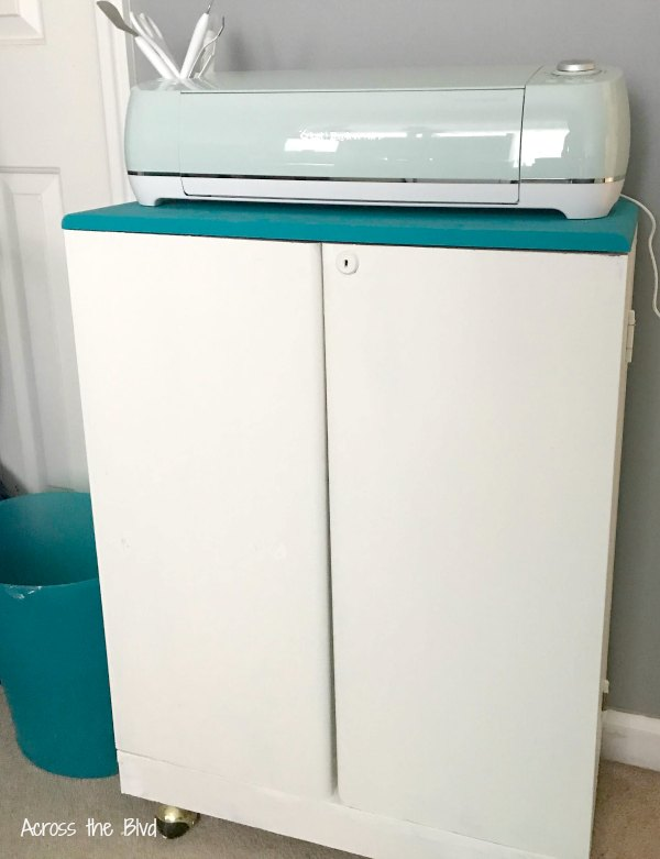 CD Cabinet Makeover with turquoise and white paint
