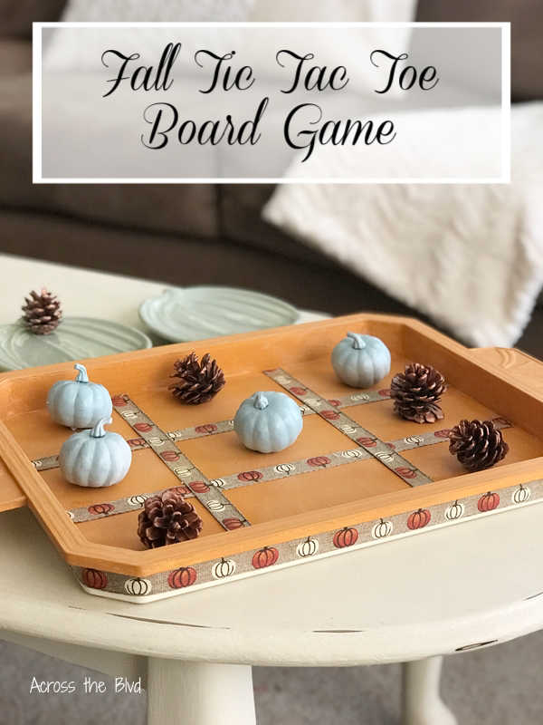 Orange Tic Tac Toe Game Board with pumpkins and pinecones
