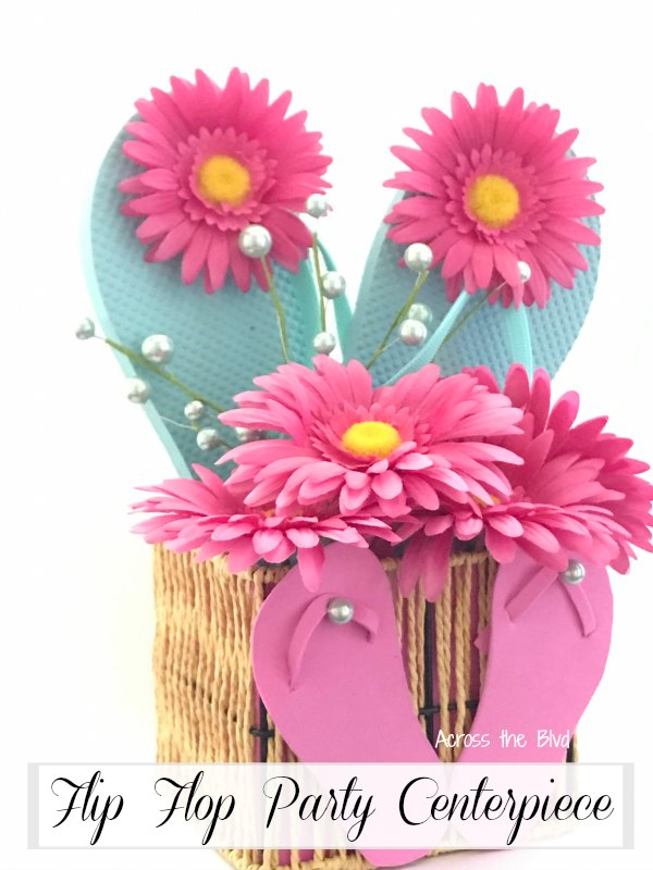 basket with flip flops and flowers for a summer party centerpiece