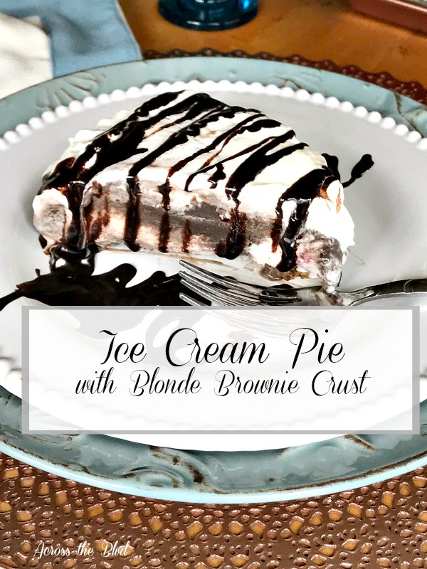 Slice of ice cream pie with brownie crust on plate