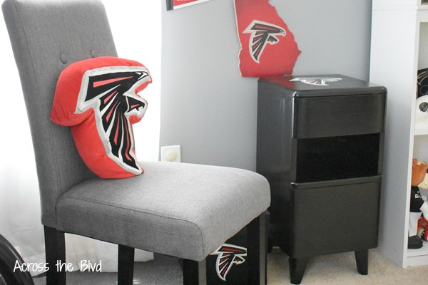 Side Table Makeover for a Sports Room with black paint next to gray chair in sports room