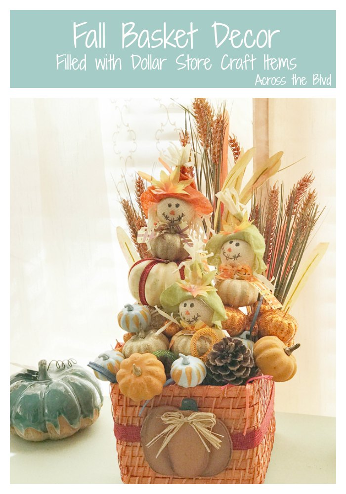 Wicker Basket filled with dollar store pumpkins, scarecrows, and floral stems