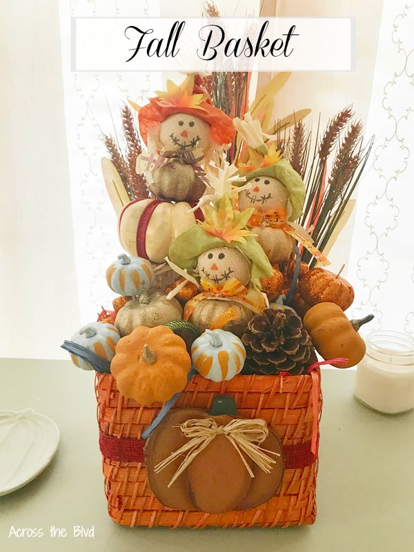 Fall Wicker Basket with pumpkins, scarecrows, and floral stems