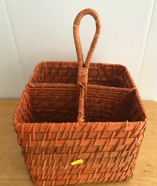Wicker basket with four sections and handle
