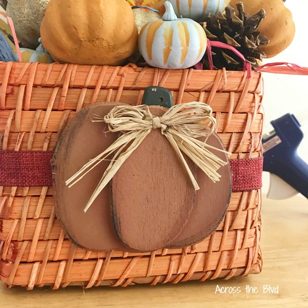 Fall basket with wooden pumpkin and ribbon