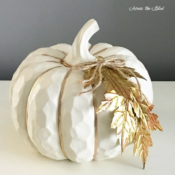 Cream colored faux pumpkin with washi tape and metal leaf