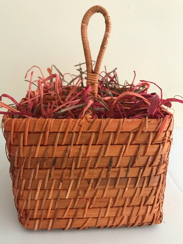 Raffia in wicker basket