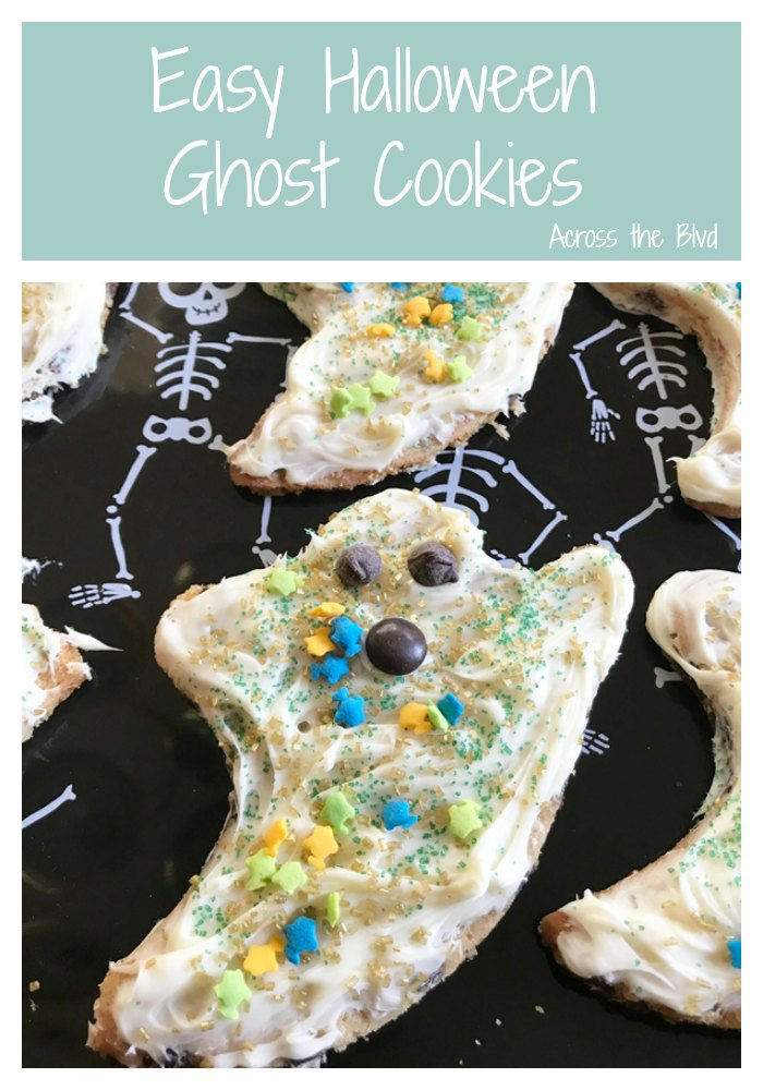 Easy Halloween Ghost Cookies with Frosting and Sprinkles on Tray