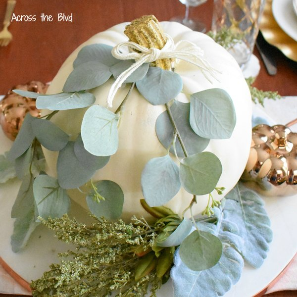 Fall Decor in the Dining Room White Pumpkin with leaf stems and greenery