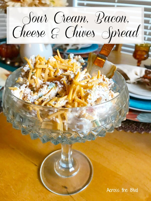 Sour Cream Bacon Cheese and Chives Spread in glass pedestal dish