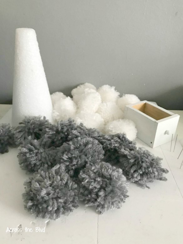 gray and white pom poms for yarn tree