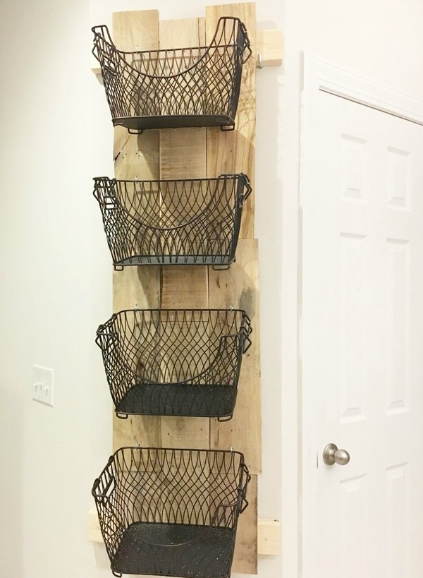 DIY Wall Mounted Fruit and Veggie Holder with black metal baskets