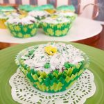 Brownie Cupcake with Marshmallow and Coconut Frosting in St. Patrick's Day Liner on Green Plate