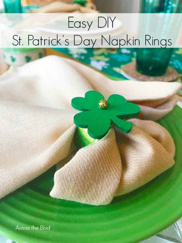 Green Shamrock Napkin Ring on Tan Napkin placed on Green Plate
