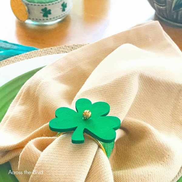 Green Shamrock Napkin Ring on tan napkin