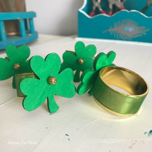 DIY Shamrock Napkin Rings with green ribbon and shamrocks with a gold bead