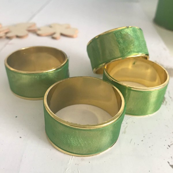 plastic gold napkin rings wrapped with green ribbon