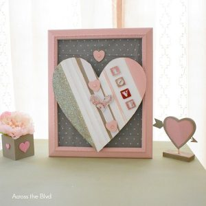 pink, white, and gray wood Valentine's Day heart in pink wood frame