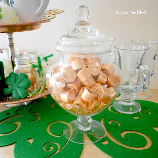 apothecary jar with gold wrapped candy