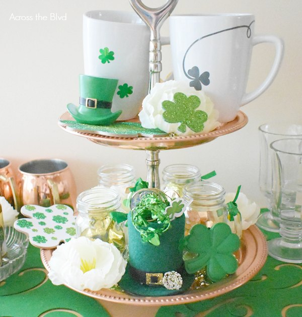 copper tiered tray with shamrocks flowers white mugs for St. Patrick's Day Decor
