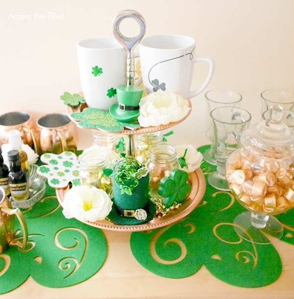 copper tiered tray with St. Patrick's Day mugs, shamrocks, and flowers
