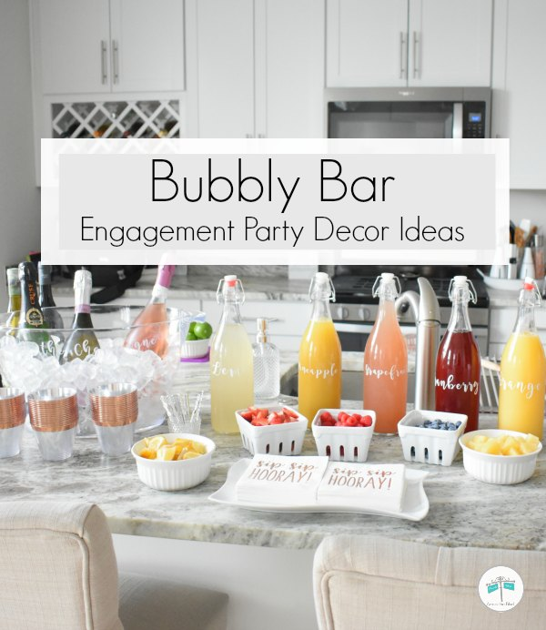 Champagne Bubbly Bar with labeled juice bottles and fruit