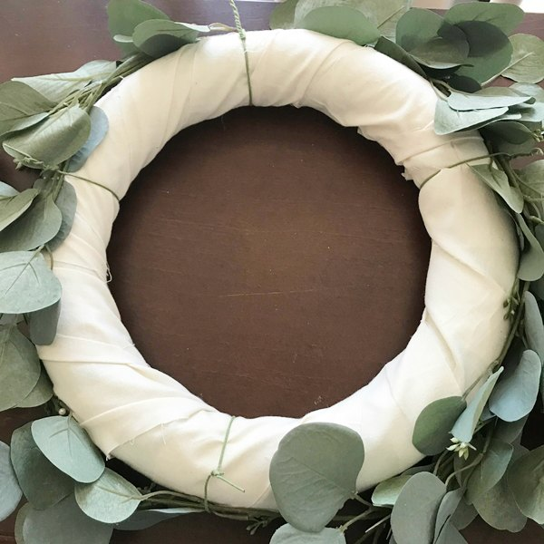 eucalyptus stems tied to wreath with floral wire