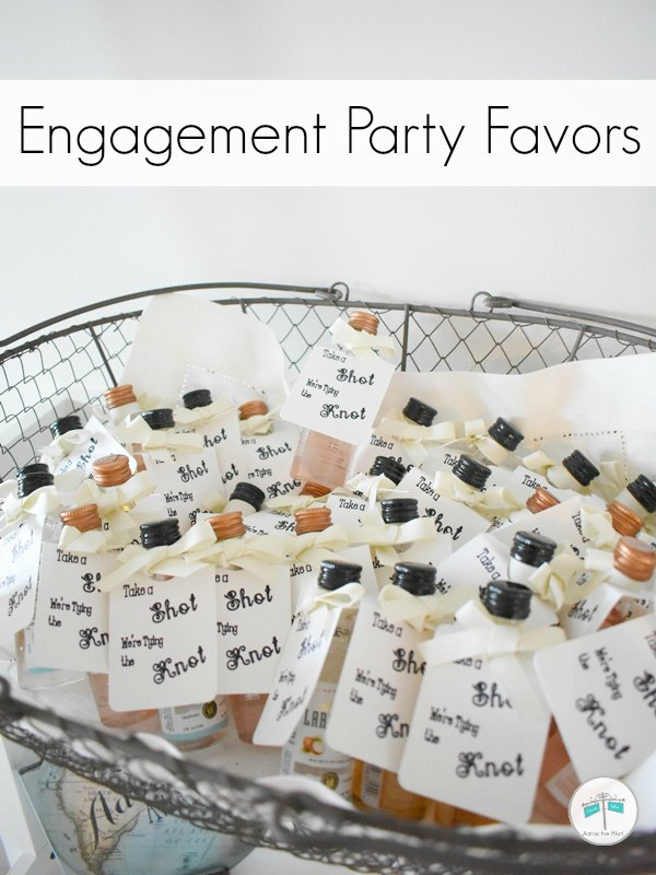 wire basket filled with mini bottle engagement party favors with tags