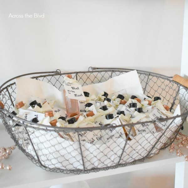 wire basket with engagement party favors