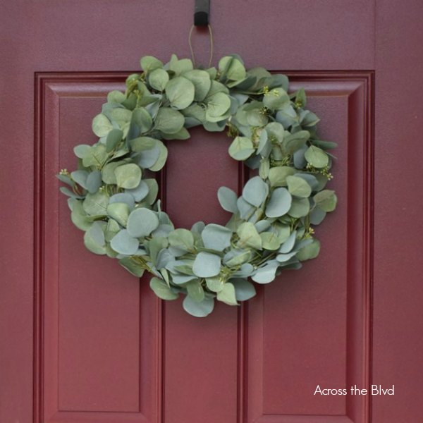 Faux Eucalyptus Wreath hanging on burgundy front door
