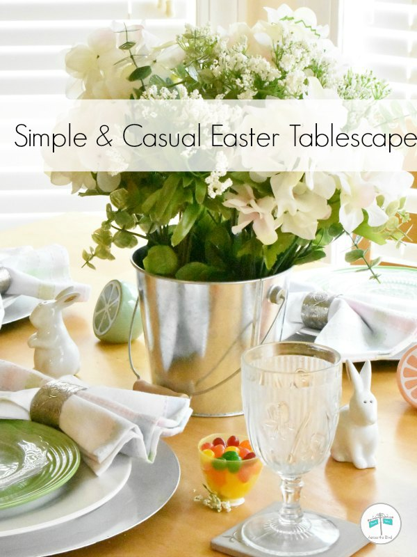 Easter Tablescape with flowers in metal pail