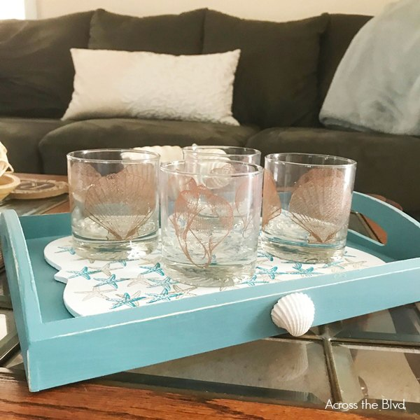 Blue Tray with Seashell Glasses on coffee table