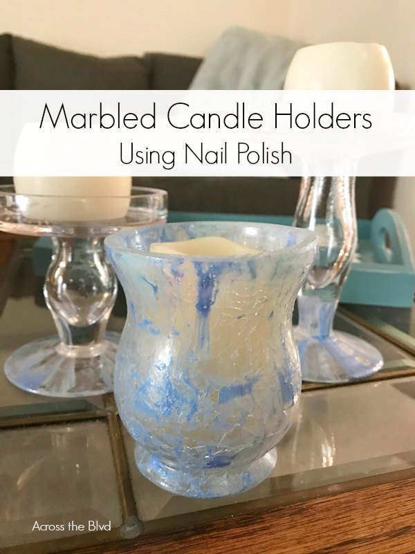 Small candle holders with marbled look made using nail polish
