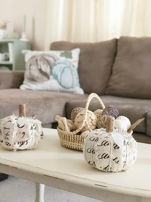 ribbon wrapped pumpkins on coffee table