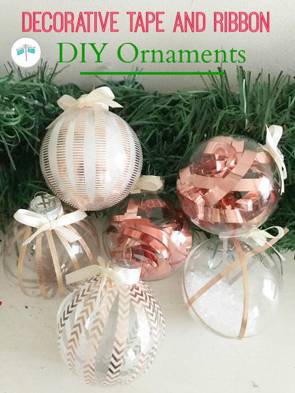 set of clear ornaments with decorative tape and ribbon