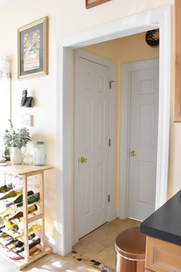 alcove off of the kitchen with pantry and laundry room