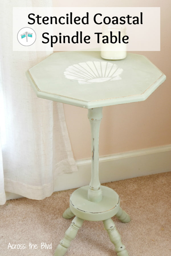 small spindle side table painted green with sea shell stencil
