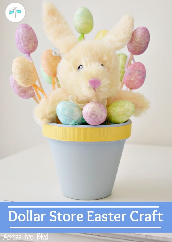 Easter Bunny Craft. Yellow stuffed bunny with colorful eggs in a blue terra cotta pot.