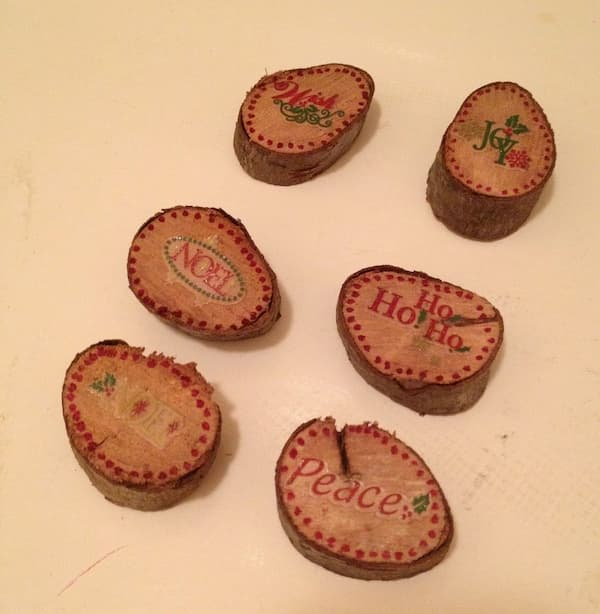 wood slice Christmas ornaments with holiday stickers