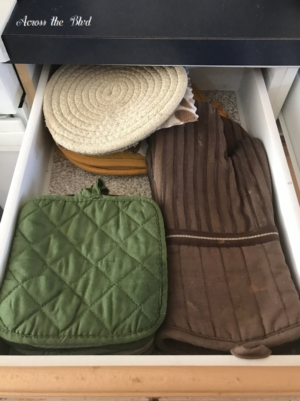 trivets and hot pads in kitchen drawer